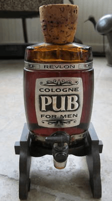 Revlon's Pub Cologne on wooden stand